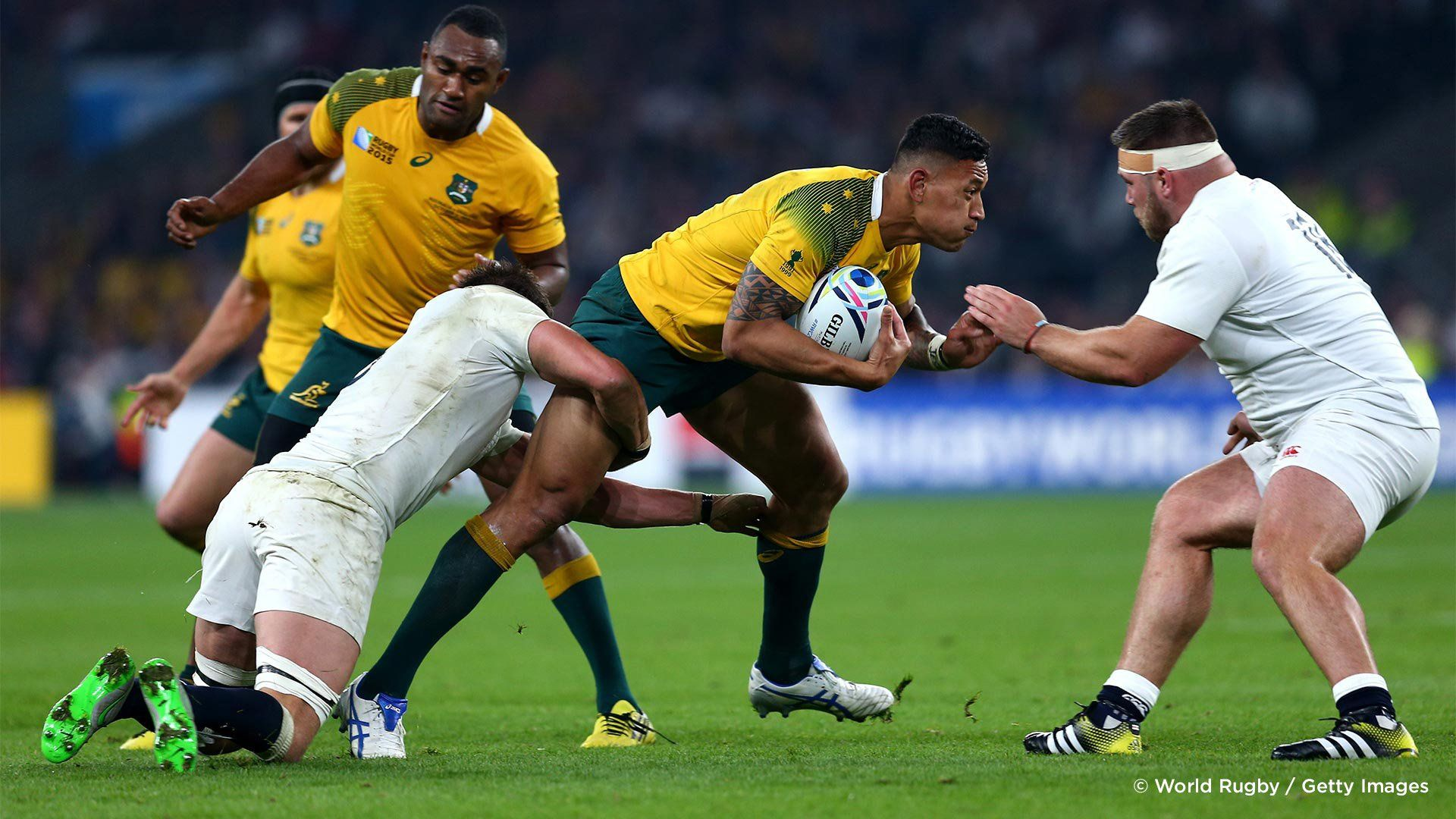 Players pictured on the point of a tackle in a match between England and Australia in the 2015 Rugby World Cup. Photo by Steve Bardens.